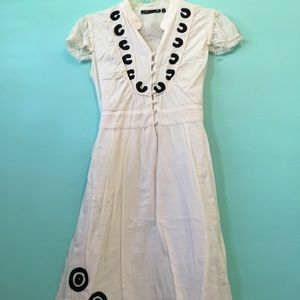 Cream dress with black embroidery. European